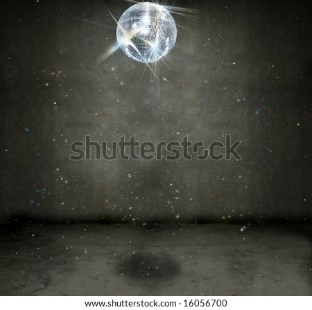 Sparkly disco ball hanging in an empty grungy room - stock photo