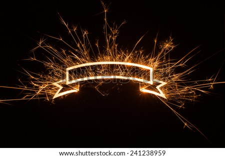 Sparkly glowing ribbon banner with copy space on dark background.