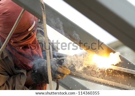 Sparks during cutting of metal by gas welding at work place - stock photo