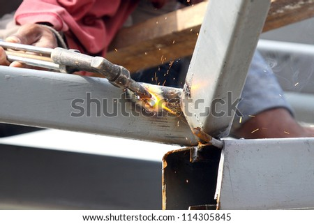 Sparks during cutting of metal by gas welding in site - stock photo