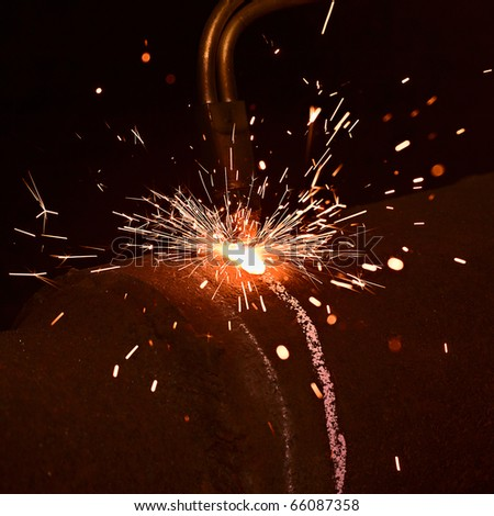 Sparks during gas welding works - stock photo