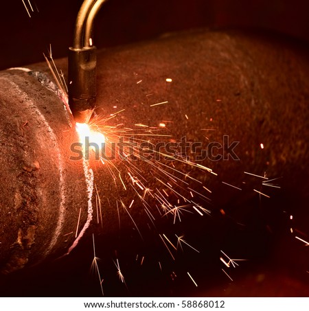 Sparks during the gas cutting of the metal - stock photo