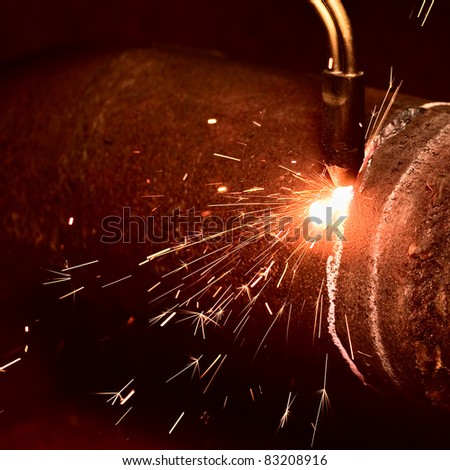 Sparks during the gas welding - stock photo