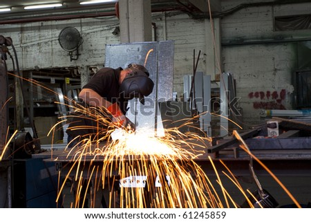 sparks during working with steel in the factory - stock photo