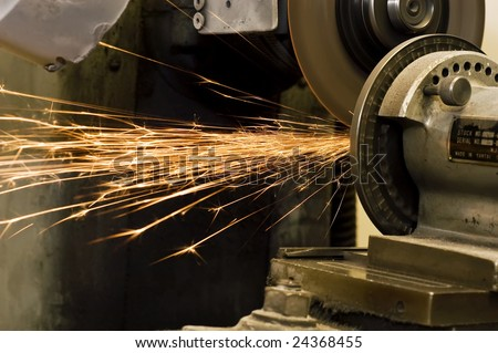 Sparks flying from an old grinder, selective focus.