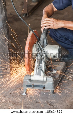 sparks frying over the working table during metal grinding