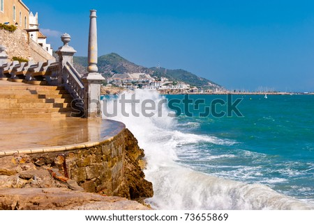 Sparks of breaking wave in Sitges, Spain. - stock photo