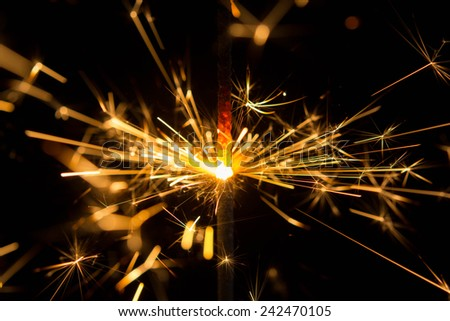 sparks on a black background electric short circuit  - stock photo