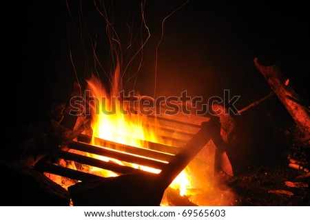 Sparks Rising from a Campfire at Nighttime