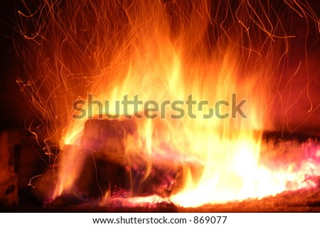 Sparks Rising from Burning Logs