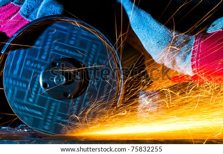 sparks while grinding iron - stock photo