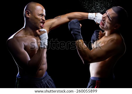 sparring mma fighters or boxers punching each other - stock photo