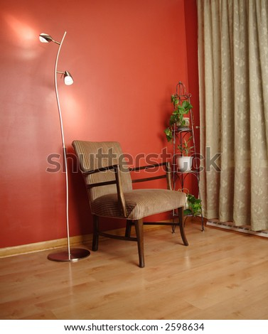 sparse room with chair and floor lamp