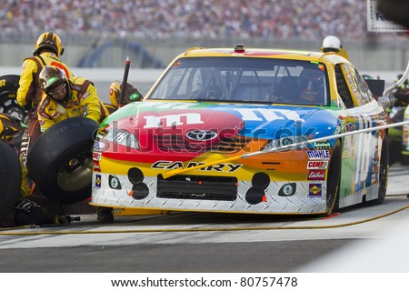 SPARTA, KY - JULY 09:  Kyle Busch (18) brings his M&Ms Toyota in for service during the Quaker State 400 race at the Kentucky Speedway in Sparta, KY on July 09, 2011. - stock photo