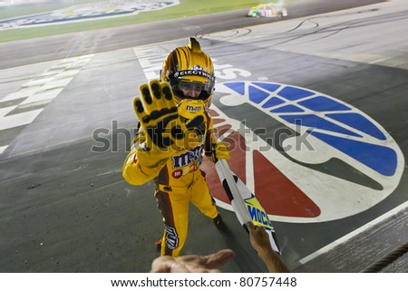 SPARTA, KY - JULY 09:  Kyle Busch (18) wins the Quaker State 400 race at the Kentucky Speedway in Sparta, KY on July 09, 2011. - stock photo