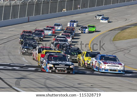 SPARTA, KY - SEP 22, 2012:  The NASCAR Nationwide Series teams take to the track for the Kentucky 300 at the Kentucky Speedway in Sparta, KY on Sept 22, 2012. - stock photo