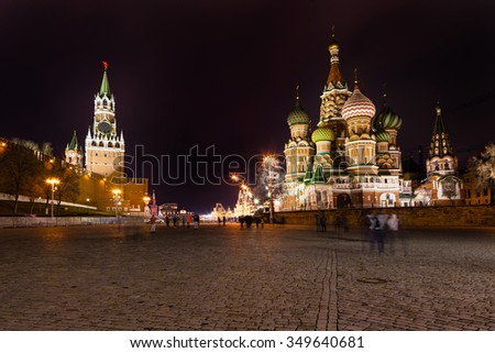Spasskaya tower of Kremlin and cathedral on Vasilevsky Descent of Red Square in Moscow in night - stock photo