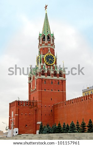 Spasskaya Tower of Moscow Kremlin. The Spasskaya Tower is the main tower with a through-passage on the eastern wall of the Moscow Kremlin, which overlooks the Red Square. - stock photo