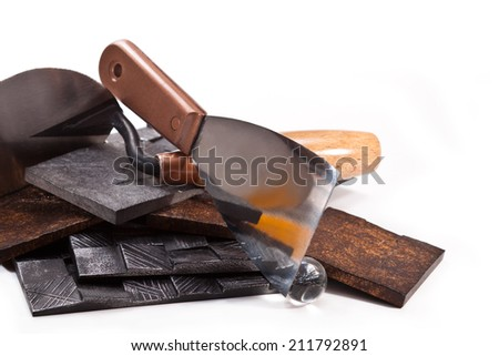 Spatula, decorative tiles, glass ball, trowel on a white background - stock photo