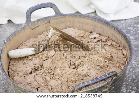 Spatula earth building materials industry - stock photo