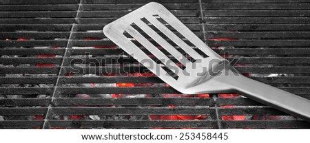 Spatula on the Empty Charcoal Barbecue Grill Close-up - stock photo