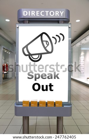 Speak out and direction sign inside shopping mall - stock photo