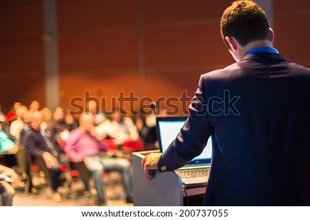 Speaker at Business Conference and Presentation. Audience at the conference hall. - stock photo