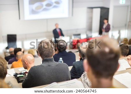 Speaker at Business Conference and Presentation. Audience at the conference hall. Business and Entrepreneurship. - stock photo