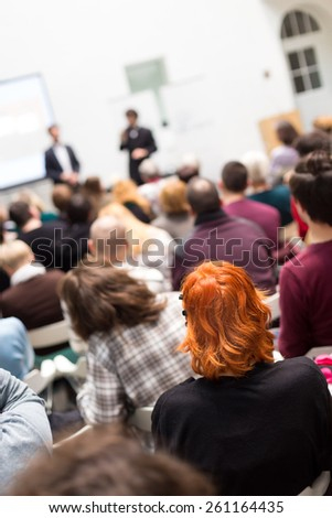 Speaker at Business Conference and Presentation. Audience in the conference hall. Business and Entrepreneurship. Copy space on white screen. - stock photo