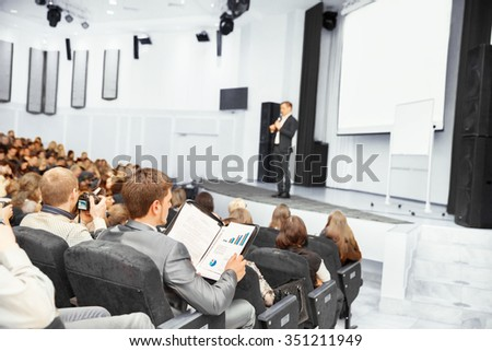 Speaker at Business convention and Presentation. Audience at the - stock photo