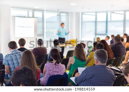 Speaker at Business convention and Presentation. Audience at the conference hall. - stock photo