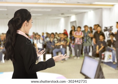 Speaker at conference and presentation. Audience at the conference hall - stock photo