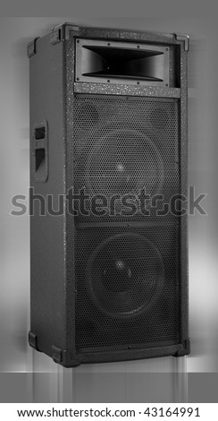 Speaker box isolated on gray - stock photo