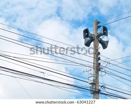 Speaker broadcasting in rural Thailand - stock photo