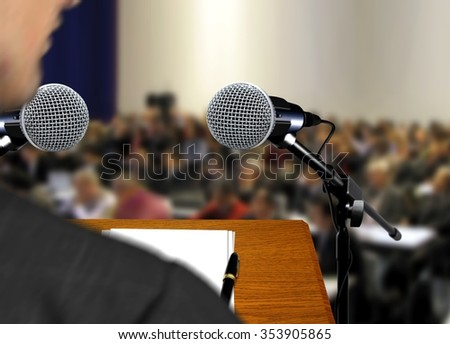 Speaker giving a speech during presentation - stock photo