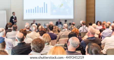 Speaker Giving a Talk at Business Meeting. Audience in the conference hall. Business and Entrepreneurship. Panoramic composition. - stock photo