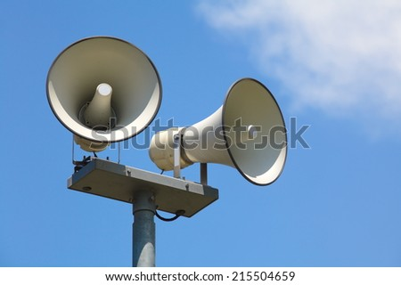 Speaker on high tower and nice blue sky  - stock photo