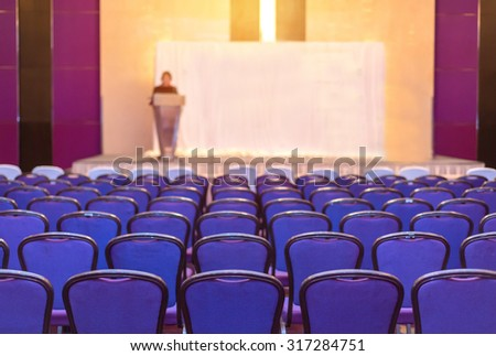 speaker prepares to lecture but people not interested in listening to lectures. - stock photo