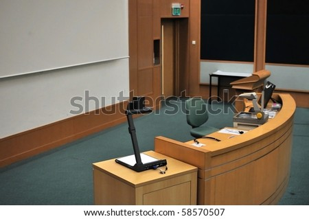 Speaker's stand in lecture hall. For concepts such as school and education, business and training, and meetings and conferences. - stock photo