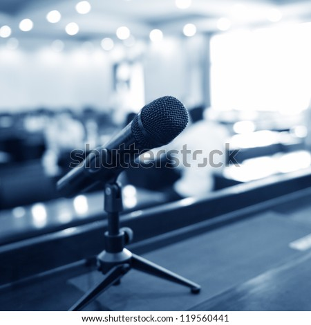 Speaker's table in conference room. - stock photo