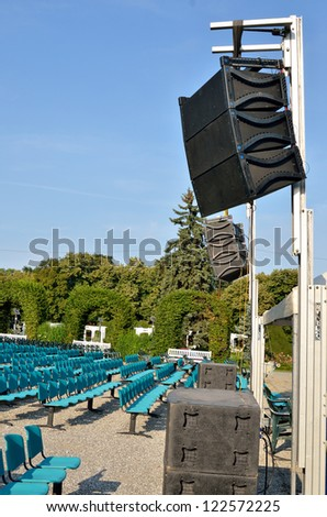 Speakers at outdoors concert - stock photo