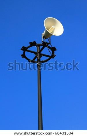 Speakers on poles. - stock photo