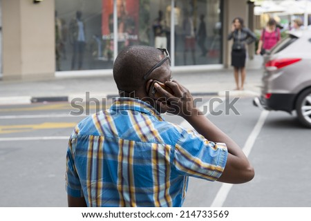 Speaking at the phone - stock photo