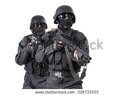 Spec ops officers SWAT in black uniform in action