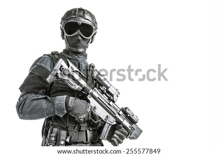 Spec ops police officer in black uniform and face mask - stock photo