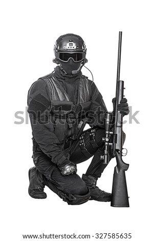 Spec ops police officer SWAT in black uniform and face mask studio shot - stock photo