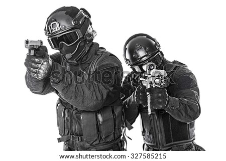 Spec ops police officers SWAT in black uniform and face mask studio shot - stock photo