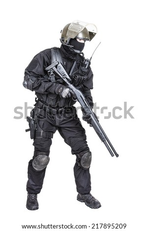 Spec ops soldier in black uniform and face mask with shotgun - stock photo