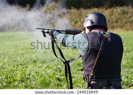 Spec ops soldier shooting shotgun. - stock photo