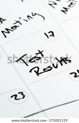 special date marked on a calendar as a concept for receiving test results - stock photo